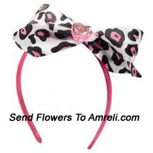 productA Designer Hair Band With A Big Bow on It