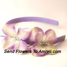 productA Designer Hair Band With Flowers On It