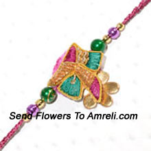 Colors Brings Happiness In Everyone's Life. A Colored Designer Rakhi For Your Brother ( Please Note That In Case Of Non-Availability Of A Certain Product We Will Substitute The Same With A Suitable Product Of Equal Or Higher Value As Per Prices On The Website. The Products Under This Category Needs To Be Accompanied With The Other Products.)