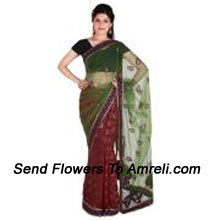 Be A Center Of Attraction In This Exclusive Net Saree