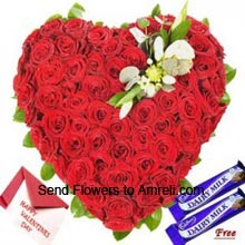productHeart Shaped Arrangement Of 100 Red Roses With Free Dairy Milk Chocolates And A Valentine's Day Greeting Card
