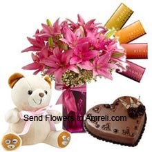 productLilies In A Vase, 1Kg (2.2 Lbs) Heart Shaped Chocolate Cake, 4 Different Cadbury's Temptation Chocolates And A Medium Size Cute Teddy Bear