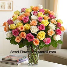 <p>36 Mixed Color Roses In A Vase</p>