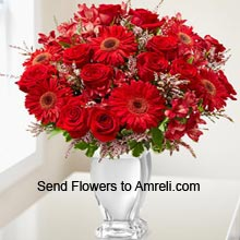 10 Red Roses And 6 Red Daisies In A Vase With Seasonal Fillers