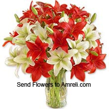 productMixed Color Lilies In A Glass Vase