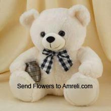 productA Cute Medium Size Teddy Bear ( Please Note That We Reserve The Right To Substitute Any Product With A Suitable Product Of Equal Value In Case Of Non Availability Of A Certain Product)