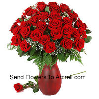 40 Red Roses And Seasonal Fillers In A Glass Vase