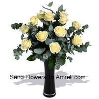product12 White Roses With Some Ferns In A Vase
