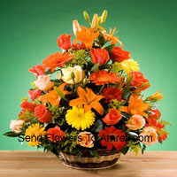 Basket Of Assorted Flowers Including Roses and Gerberas Of Assorted Color. This Basket Also Has Seasonal Fillers