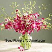 Orchids With Seasonal Fillers In A Vase