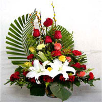 Basket Of Assorted Flowers Including Lilies, Roses And Carnations
