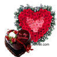productHeart Shaped Arrangement Of 50 Red Roses And A 1 Kg (2.2 Lbs) Chocolate Truffle Cake