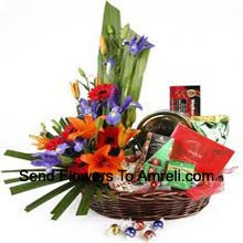 Assorted Flowers In A Basket With Assorted Chocolates (Please Note That We Reserve The Right To Substitute Any Product With A Suitable Product Of Equal Value In Case Of Non-Availability Of A Certain Product)