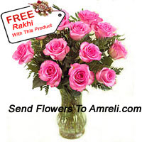product12 Pink Roses With Some Ferns In A Glass Vase With A Free Rakhi