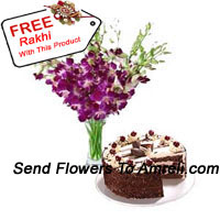 Orchids In A Vase Along With 1 Kg Black Forest Cake And A Free Rakhi