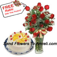 24 Red Roses With Some Ferns In A Vase Along With A 1/2 Kg Vanilla Cake And A Free Rakhi