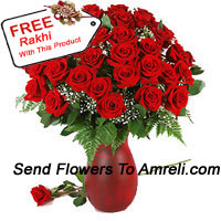 product40 Red Roses And Seasonal Fillers In A Glass Vase With A Free Rakhi
