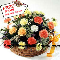 Basket Of 24 Mixed Colored Carnations With Seasonal Fillers And A Free Rakhi