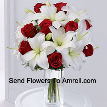 This product is a sleek and elegant way to spread goodwill for the holiday season. Red roses are set to catch the eye arranged amongst white Oriental lilies in a clear glass cylinder vase wrapped in silver ribbon to create a seasonal display of heartfelt wishes for a magical holiday. (Please Note That We Reserve The Right To Substitute Any Product With A Suitable Product Of Equal Value In Case Of Non-Availability Of A Certain Product)
