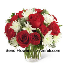 This Bouquet�is a charming display of holiday beauty and winter warmth. Rich red roses and spray roses pop against white chrysanthemums, assorted Christmas greens and eucalyptus, arranged in a round clear glass vase to create a gift that will spread the goodwill of the season to your special recipient. (Please Note That We Reserve The Right To Substitute Any Product With A Suitable Product Of Equal Value In Case Of Non-Availability Of A Certain Product)