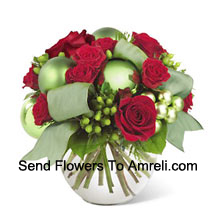This new holiday bouquet combines festive red roses, spray roses and more with bright green ornaments and seasonal accents for a classic look with a contemporary new twist!� (Please Note That We Reserve The Right To Substitute Any Product With A Suitable Product Of Equal Value In Case Of Non-Availability Of A Certain Product)
