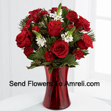 productThis romantic arrangement bristles with the passion and wonder of the Christmas season. Rich red roses and burgundy mini carnations accented with the snowy white blooms of Stars of Bethlehem, pine branches, and lush greens will easily sweep them off their feet. Arranged in a ruby red clear glass vase, this bouquet conveys your most heartfelt holiday wishes. (Please Note That We Reserve The Right To Substitute Any Product With A Suitable Product Of Equal Value In Case Of Non-Availability Of A Certain Product)