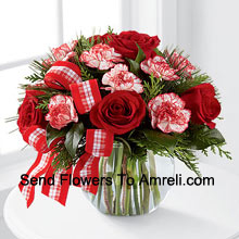 Send warm wishes and bright sentiments for a wonderful holiday season! Rich red roses and peppermint carnations are delicately arranged with holiday greens to create a festive display. Arriving in a clear glass bubble bowl and accented with a red and white plaid ribbon, this arrangement is full of seasonal sophistication. (Please Note That We Reserve The Right To Substitute Any Product With A Suitable Product Of Equal Value In Case Of Non-Availability Of A Certain Product)