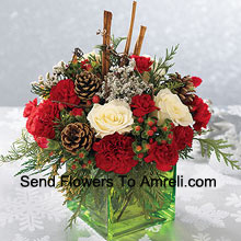 Send this bouquet of holiday colours - white roses, red carnations and Christmas greens - to express your happiest holiday wishes. Arranged in a glass cube with cinnamon sticks and pinecones, it's a wonderful gift for anyone on your list (Please Note That We Reserve The Right To Substitute Any Product With A Suitable Product Of Equal Value In Case Of Non-Availability Of A Certain Product)