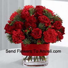 productThis Bouquet is a cheerful expression of all the merry moments this holiday season has to offer. Bright red spray roses, red mini carnations, burgundy mini carnations, red hypericum berries and assorted holiday greens are elegantly arranged in a clear glass vase bedecked with a rich red ribbon to create a holiday greeting in the spirit of this wondrous season of giving and gratitude. (Please Note That We Reserve The Right To Substitute Any Product With A Suitable Product Of Equal Value In Case Of Non-Availability Of A Certain Product)