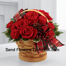 productGreet your special recipient with seasonal beauty and blessings. Red roses and mini carnations are gorgeously arranged in a natural woodchip basket with assorted holiday greens, natural pinecones, and berry pics, accented with a tartan plaid ribbon to create a gift that wishes everything this wondrous season has to offer (Please Note That We Reserve The Right To Substitute Any Product With A Suitable Product Of Equal Value In Case Of Non-Availability Of A Certain Product)