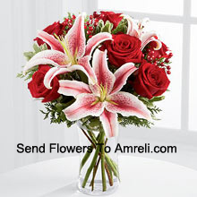 productThis Bouquet�is a simply stunning display of seasonal glamour they won't be able to resist. Rich red roses are paired with the dazzling beauty of Stargazer lilies accented with holiday greens, berry sprays and a bordeaux satin rbbon for an elegant look. Arranged in a clear glass vase, this bouquet will add to the magic and wonder of their holiday festivities. (Please Note That We Reserve The Right To Substitute Any Product With A Suitable Product Of Equal Value In Case Of Non-Availability Of A Certain Product)