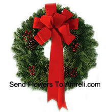productThis stylish wreath with an extravagant red silk ribbon is made so your dear ones can celebrate Christmas with style (Please Note That We Reserve The Right To Substitute Any Product With A Suitable Product Of Equal Value In Case Of Non-Availability Of A Certain Product)