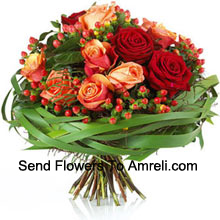 A Delightful bouquet of Red and Orange Roses with seasonal fillers (Please Note That We Reserve The Right To Substitute Any Product With A Suitable Product Of Equal Value In Case Of Non-Availability Of A Certain Product)