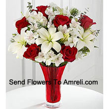 This Bouquet�is a gorgeous expression of yuletide joy and elegance. Red roses pop against a background of white Asiatic lilies and Peruvian lilies lovingly arranged in a red designer glass vase to create a bouquet of seasonal celebration. (Please Note That We Reserve The Right To Substitute Any Product With A Suitable Product Of Equal Value In Case Of Non-Availability Of A Certain Product)