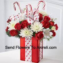 productThis Bouquet will dazzle them with its whimsical joy and spirited beauty! A gorgeous arrangement of white mums, red carnations and spray roses sit amongst holiday greens in a shiny red vase adorned with candy canes and wrapped to perfection with a beautiful bow, making it look like the finest holiday gift. (Please Note That We Reserve The Right To Substitute Any Product With A Suitable Product Of Equal Value In Case Of Non-Availability Of A Certain Product)