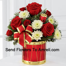 productA blossoming display of seasonal merriment and festive greetings. Rich red roses and spray roses sweetly mingle with white chrysanthemums arranged amongst lush holiday greens, all perfectly accented with drum pics and a gold-edged red ribbon. Arriving in a designer red and gold drum inspired vase, this bouquet will express your most heartfelt wishes for a wonderful holiday season. (Please Note That We Reserve The Right To Substitute Any Product With A Suitable Product Of Equal Value In Case Of Non-Availability Of A Certain Product)
