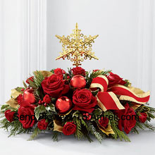 productA grand and elegant way to add to the beauty of their holiday festivities. Rich red roses and spray roses are arranged with assorted holiday greens, variegated holly, shiny red holiday balls and a gold-edged red ribbon, all encircling a gold metallic star-shaped tree topper to create a unique and sophisticated holiday centerpiece.� (Please Note That We Reserve The Right To Substitute Any Product With A Suitable Product Of Equal Value In Case Of Non-Availability Of A Certain Product)