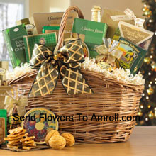 Brighten someone's day with a cheerful sampler of gourmet goodies. Nestled inside this distinctive basket are the finest gourmet treats including Toasted Praline Coffee, Chocolate Wafer Rolls, French Herb Cheese Mix, Fancy Water Crackers, Dutch Gouda Cheese Biscuits, Smoked Almonds, Cashew Brittle, Belgian Chocolates, Mixed Fruit Candies, Cheese Lover's Pub Mix, Golden Walnut Caramel Cookies, Sisters Green Tea and non-alcoholic Sparkling Apple Cider. (Please Note That We Reserve The Right To Substitute Any Product With A Suitable Product Of Equal Value In Case Of Non-Availability Of A Certain Product)