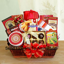 Send your wishes for happy holidays to everyone on your gift list this year with our gourmet gift basket designed just for the occasion. Our delightful tray basket holds Walker's holiday shortbread cookies, Ghirardelli chocolate assortment, Jelly Belly jelly beans, butter toffee pretzels, truffle cookies, cheese swirls, smoked almonds, cheese, English tea cookies, water crackers, and a Ghirardelli chocolate bar. The variety makes it perfect when you want to make sure there is something for everyone to enjoy. They'll love the elegant presentation with a big bow on the front, and can keep the wicker basket to use long after the food has been enjoyed (Please Note That We Reserve The Right To Substitute Any Product With A Suitable Product Of Equal Value In Case Of Non-Availability Of A Certain Product)