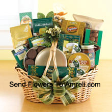 Start a tradition of sending good taste to everyone on your holiday gift list this year. Our classic wicker basket comes piled high with a gourmet assortment that is sure to please. Whether you need something to send to corporate clients or your favorite aunt and uncle, this gift basket is up to the job. We accent the basket with green and gold ribbon and holiday accents to make a great impression. Inside your recipients will discover an assortment that features something for everyone: Lindt chocolate truffles, smoked almonds, walnut cookies, chocolate cookies, chocolate-covered popcorn, cheese, crackers, a Ghirardelli chocolate bar, tortilla chips, salsa, chocolate wafer cookies , cheese swirls, and chocolate-covered sandwich cookies. (Please Note That We Reserve The Right To Substitute Any Product With A Suitable Product Of Equal Value In Case Of Non-Availability Of A Certain Product)