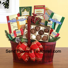 Our handsome red splitwood handle basket is all decked out in holiday splendor, and packed with a sweet sampling of Ghirardelli's greatest chocolate creations. There's plenty inside to discover and enjoy, and the sweet excess will keep your recipients smiling for days. We've included: two gift bags of Ghirardelli squares (mint chocolate & dark chocolate), truffle cookies, a caramel chocolate bar, hot cocoa mix, and an assortment of Ghirardelli chocolate squares. We top it off with a festive bow, and add silk greenery and accents to make sure this Christmas present is a memorable one (Please Note That We Reserve The Right To Substitute Any Product With A Suitable Product Of Equal Value In Case Of Non-Availability Of A Certain Product)