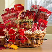 The people have spoken, and they choose... this gourmet gift basket for Christmas! This best selling basket is a true charmer, presenting the perfect blend of sweet and savory treats for the season. Our wicker basket is overflowing with Smoked Ham Sausage, Sharp Cheddar Cheese, Fancy Water Crackers, North Carolina Roasted Peanuts, salty and sweet Kettlecorn, Dutch Cheese Butterfly Biscuits, English Assam Tea and Old North State Blend Coffee. For dessert we have included Chocolate Truffles, Scottish Shortbreads, Ballerina Cookies and German Chocolate Cake. (Please Note That We Reserve The Right To Substitute Any Product With A Suitable Product Of Equal Value In Case Of Non-Availability Of A Certain Product)