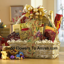 This gift basket shines for the holidays with a great selection of gourmet food for all. A shimmering basket holds Dutch Gouda Cheese Biscuits, Crantastic Snack Mix, Chocolate Cocoa, Scottish Shortbread Fingers, Roasted Peanuts, assorted Godiva Dark Chocolates, Smoky Cheddar, Fancy Water Crackers, Swedish Ballerina Cookies, Holiday Mints, Bellagio Caramella Coffee, Christmas Tea, and non-alcoholic Sparkling Apple Cider. It makes a nicely balanced selection of sweet and savory foods that are sure to please. (Please Note That We Reserve The Right To Substitute Any Product With A Suitable Product Of Equal Value In Case Of Non-Availability Of A Certain Product)