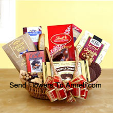 productSatisfy their sweet tooth this year with a gift dedicated to chocolate indulgence! Our wicker basket comes brimming with a vast array of gourmet treats, all celebrating the many reasons to love chocolate. Its sweet excess includes Beth's chocolate chip cookies, English toffee, Chocolate truffle cookies, biscotti, Lindt truffles, Cashew Roca and a Ghirardelli chocolate bar. It's one present they'll have a hard time not opening before Christmas! (Please Note That We Reserve The Right To Substitute Any Product With A Suitable Product Of Equal Value In Case Of Non-Availability Of A Certain Product)