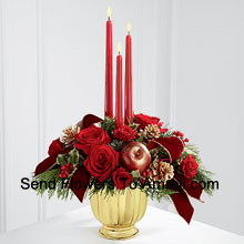 The grandeur and rich beauty of the Christmas season are highlighted with each crimson bloom. Bright red roses and spray roses are arranged in a designer gold container amongst variegated holly and assorted holiday greens. Accented with artificial apples, gold pinecones and gold-edged burgundy ribbon, this gorgeous centerpiece displays three red taper candles to create the perfect atmosphere for their holiday celebration.� (Please Note That We Reserve The Right To Substitute Any Product With A Suitable Product Of Equal Value In Case Of Non-Availability Of A Certain Product)