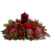 Celebrate a traditional family Christmas with this wonderful holiday centerpiece. Red carnations, Red Roses surround a red pillar candle, and a fancy ribbon adds a special touch! A lovely way to light the holiday table or a pretty sideboard decoration. (Please Note That We Reserve The Right To Substitute Any Product With A Suitable Product Of Equal Value In Case Of Non-Availability Of A Certain Product)
