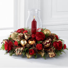 The Golden Christmas Centerpiece is the perfect display of holiday warmth and cheer to gather your friends and family together. Bright red roses and mini carnations are gorgeously arranged with holiday greens  And A Candle (Please Note That We Reserve The Right To Substitute Any Product With A Suitable Product Of Equal Value In Case Of Non-Availability Of A Certain Product)