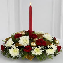 The Light & Love Holiday Centerpiece adds that special touch to any seasonal gathering. White Gerberas and burgundy mini carnations are accented with lush holiday greens  gorgeously arranged around a burgundy taper candle, to create a warm wish for a perfect holiday season. (Please Note That We Reserve The Right To Substitute Any Product With A Suitable Product Of Equal Value In Case Of Non-Availability Of A Certain Product)