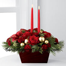 An exquisite display of holiday beauty to add warmth and cheer to their special celebrations. Rich red roses and burgundy mini carnations are set to impress surrounded by lush holiday greens, seeded eucalyptus, gold glass balls and a gold-edged red ribbon arranged elegantly around two red taper candles. Presented in a chocolate brown bamboo�container, this centerpiece will usher in joy and goodwill with each treasured bloom (Please Note That We Reserve The Right To Substitute Any Product With A Suitable Product Of Equal Value In Case Of Non-Availability Of A Certain Product)