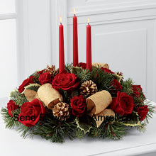 This Centerpiece�is a grand display of holiday elegance. Red roses and And Other Assorted Flowers pop against a backdrop of assorted holiday greens and variegated holly that beautifully encircle three red taper candles. Ths centerpiece creates a warm and enchanting glow to benefit their holiday festivities. (Please Note That We Reserve The Right To Substitute Any Product With A Suitable Product Of Equal Value In Case Of Non-Availability Of A Certain Product)